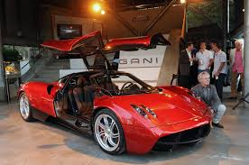 pagani huayra red epic pic red pagani huayra front side view doors up and horacio