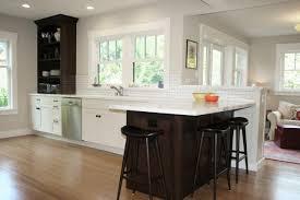 bright white kitchen wood peninsula sleek saddle stools surround