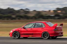 mitsubishi evo 8 red 2004 mitsubishi lancer evolution viii four play photo u0026 image