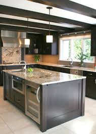 two island kitchen kitchen laminate wooden floor two level kitchen island pendant