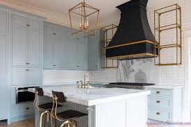 gray kitchen cabinets with gold and black kitchen hood sherwin