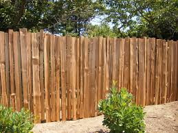 staggered grape stake fencing fencing ideas pinterest wood