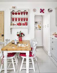 white country kitchen with red accessories make a short hallway