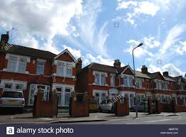 street with typical british houses ilford east london uk stock