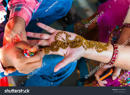 indian woman gets henna tattoos on stock photo 108438059