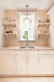 tumbled marble tile transitional kitchen aidan design