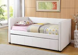 White Daybed With Pop Up Trundle White Leather Daybed With Trundle And Grey Blanket On The Floor Of