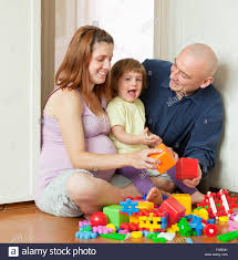 easter plays for children happy parents plays with child in home interior stock photo