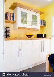 white kitchen cabinets yellow walls wall cupboard in modern yellow kitchen with fitted white