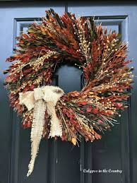 calypso in the country fall wreath tip dried on front door you
