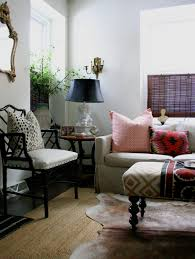 dm living room layered cowhide over jute rug patterened ottoman