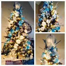 whimsical blue silver and white themed christmas tree with