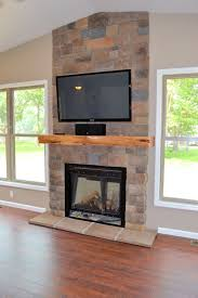 interior architecture fireplace stone wall and electric fireplace