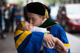 infant graduation cap and gown school of medicine and dentistry commencement ceremony 2014