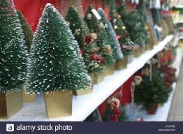 small artificial trees on sale at a garden centre in the
