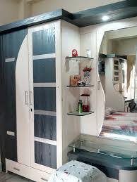 hidden wardrobe behind bed headboard with closet storage interior