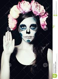 meisje met halloween make up sugar skull woman stock foto