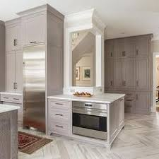 Organization In The Kitchen - coffee station with pocket doors great idea for organization in