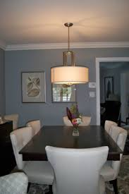 upscale townhouse dining room with custom dining table and cream