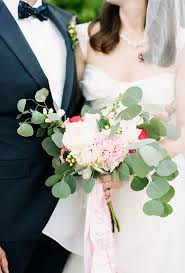 wedding flowers eucalyptus hydrangea groomsmen boutonnieres white peonies peony and white