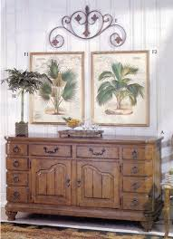 sideboard with native palm prints and faux palm tree from the sideboard with native palm prints and faux palm tree from the ballard designs catalog