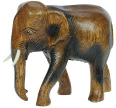 carved wooden elephant ornament top and birthday