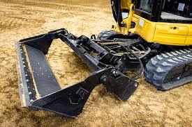 caterpillar u0027s new 304 5e2 xtc is half excavator half skid steer