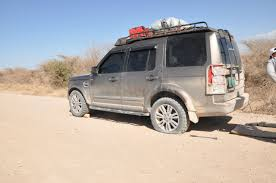 land rover lr4 white black rims voyager racks