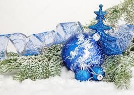 beautiful blue christmas balls on frosty fir tree christmas