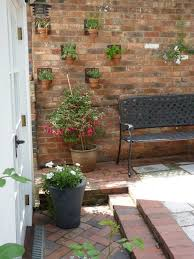 garden brick wall design ideas patio traditional with herringbone