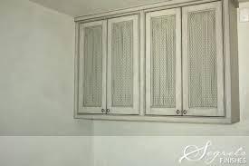 chicken wire cabinet door inserts fabric cabinet doors chicken wire storage cabinets secrets of