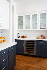 best navy kitchen ideas pinterest cabinets find this pin and more kitchens navy white brass kitchen with wood floors cabinets