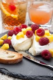 warm baked brie cheese with fresh mango and raspberries great