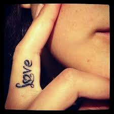 amazing love lettering tattoo on finger