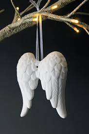 beautiful white ceramic wings conjur up images of school