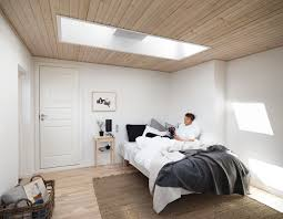 velux flat roof window in bedroom bringing daylight to your home