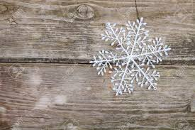 christmas decorations snowflake on a wooden background stock