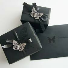 black wrapping paper use black wrapping paper and coordianated black embellishments for