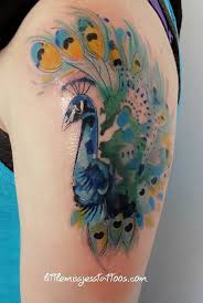 the 25 best watercolor peacock tattoo ideas on pinterest