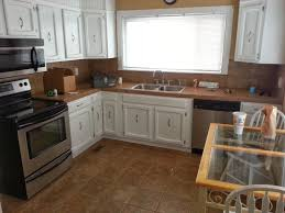 kitchens with different colored islands granite countertop built in custom cabinets classic backsplash