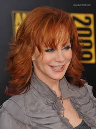 hairstyle bangs for fifty plus reba mcentire long chiseled hairstyle for 50 plus redhead women