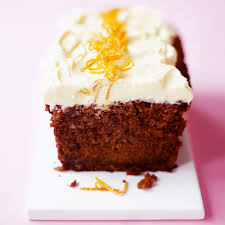 beetroot cake with orange frosting woman and home