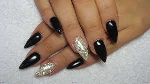 a starry night with black and silver acrylic nails design