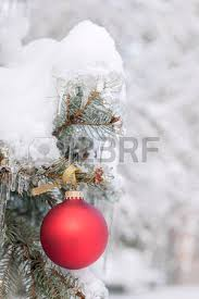 ornament on tree branch with icicles stock photo