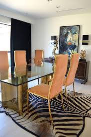 brass glass dining table peach gold dining chairs brass and glass dining table zebra rug