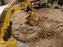 a scale hole dug by a scale cat excavator catmodels cat machine