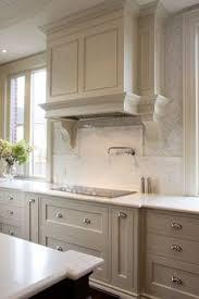 Gray Kitchen Cabinets With White Fan Tile Backsplash - Gray kitchen cabinet