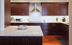 white kitchen countertops with brown cabinets premier kitchens the granada kitchen