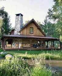 House With Wrap Around Porch Log Cabin With A Tin Roof And A Wrap Around Porch This Is My