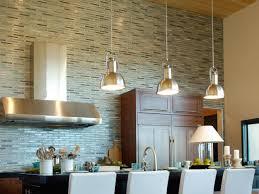 striped kitchen tile backsplash with 3 iron chandelier plus island